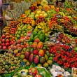 La Boqueria fruits stall. World famous Barcelona market, Spain. - Stock Photo