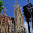 Stock Photo: Pl. SagradFamilia. Traffic light and church. Barcelona, Spain.