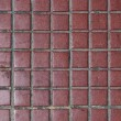 Stock Photo: Old red tiled floor. Good as backdrop or background.