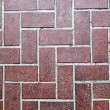 Floor tiled with red bricks. Good as backdrop or background. — Stock Photo