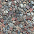 Textured pebble sidewalk background. — Stock Photo