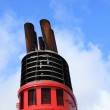 Chimney of big cruise ship and blue sky in background. — Foto de Stock