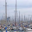 Stock Photo: Yachts and sail boats in Barcelona harbour.