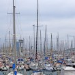 Yachts and sail boats in Barcelona harbour. — Stock Photo #7993623