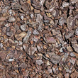 Royalty-Free Stock Photo: Shredded brown bark as decoration for garden. Good as background
