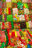 Huge amount of colored sweet things at Barcelona market as backg — Stock Photo