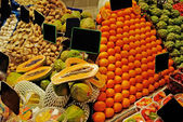 La Boqueria rows of fruits. World famous Barcelona market, Spain — Stock Photo