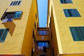 Yellow architecture of small Lloret de Mar city. Costa Brava, Sp — Stock Photo