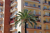 Green palm, hotel and luxury apartments in Lloret de Mar, Spain. — Stock Photo
