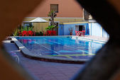 Natural framed photo of hotel pool in Spain. — Stock Photo