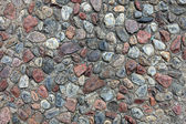 Textured pebble sidewalk background. — Stock Photo