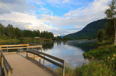 Pier on lake in Norway before sunset, Scandinavian Europe. — Stock Photo