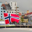 Harbor of the city of Bergen. Focus on norwegian flag. Summer sc — Stock Photo