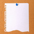 Royalty-Free Stock Photo: Torn note paper attached with blue pin to cork board, good as ba