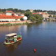 Small touristic ship on the river in Prague. — Stock Photo