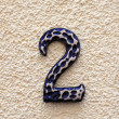 Number two made of metall on textured surface. — Foto Stock