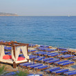 Stock Photo: Lot of deck chairs with VIP o nbeach of Nice city, France.
