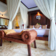 Luxury tropical villa bedroom, Bali, Indonesia. - Stock Photo