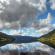 Beautiful norwegilake with reflection of dramatic sky, scandi — Stock Photo #8109739