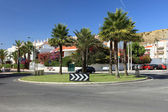 Circle crossroad with palms in Lisbon, Portugal. — Stock Photo