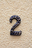 Number two on textured surface. — Stock Photo