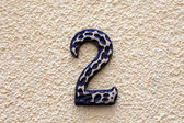 Number two made of metall on textured surface. — Stock Photo
