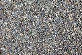 Samlade stenar som texturerat bakgrund. — Stockfoto