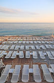 Lot of deck-chairs at the beach of city of Nice, France, Cote d' — Stock Photo