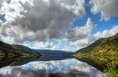 Beautiful norwegian lake with reflection of dramatic sky, scandi — Stock Photo