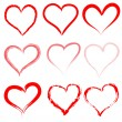 Collection of red artistic hand drawn hearts. — Stock Vector