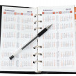 Calendar in notebook with pen — Stock Photo #9805711