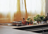 Vegetables on the steel sink in a modern kitchen — Stock Photo