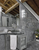 Modern bathroom in the attic room — Stock Photo