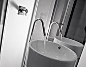Detail of modern washbasin and faucet — Stock Photo