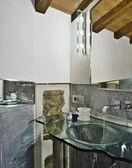 Modern bathroom with glass washbasin — Stock Photo