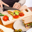 Halving homemade healthy vegetable sandwich - Stock Photo
