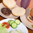 Serving hamburgers with cheese and vegetable — Stock Photo