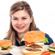 Happy woman with hamburgers — Stock Photo #10096894