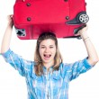 Stock Photo: Happy traveller woman with luggage