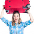 Stockfoto: Happy traveller woman with luggage