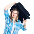 Stock Photo: Nervous traveller woman with luggage