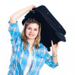图库照片: Nervous traveller woman with luggage
