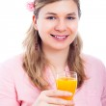 Happy woman with glass of orange juice — Stock Photo #10541417