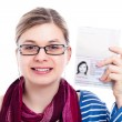 Happy tourist traveller woman with passport — Stock Photo