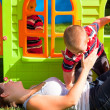 Happy family and colorful playhouse — Stock Photo #8097799