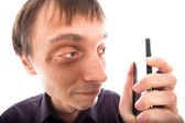Ugly weirdo man looking at cellphone — Stock Photo