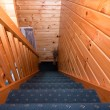 Stock Photo: Detail of staircase in wooden lodge apartment