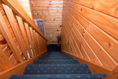 Detail of staircase in wooden lodge apartment — Stock Photo
