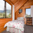 Interior of mountain wooden lodge bedroom — Stock Photo