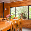 Interior detail of wooden lodge dining room — Stock Photo